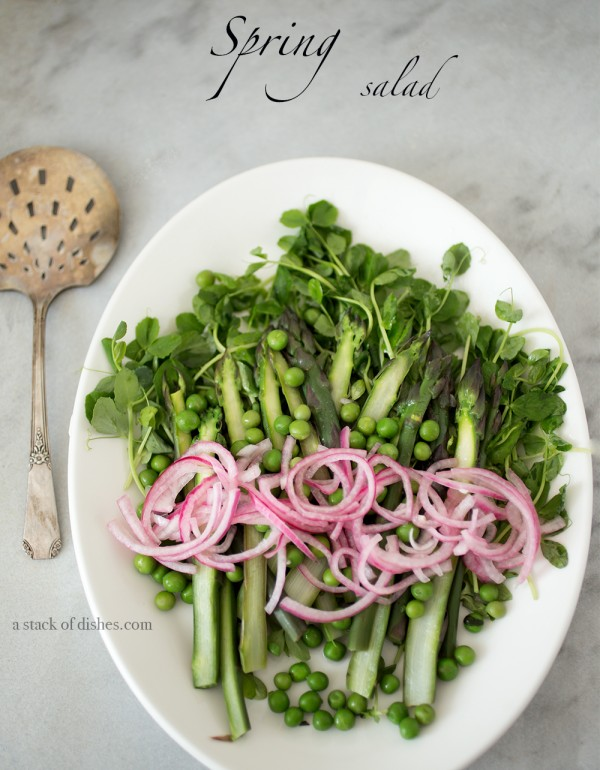 asparagus and garden pea salad, spring greens, spring vegetables, a stack of dishes