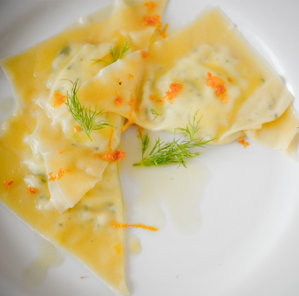 Goat Cheese Raviolo- A Stack of Dishes