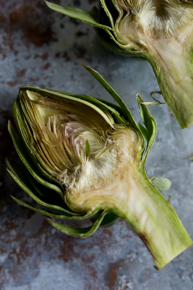 Cut Artichokes before Searing- A Stack of Dishes