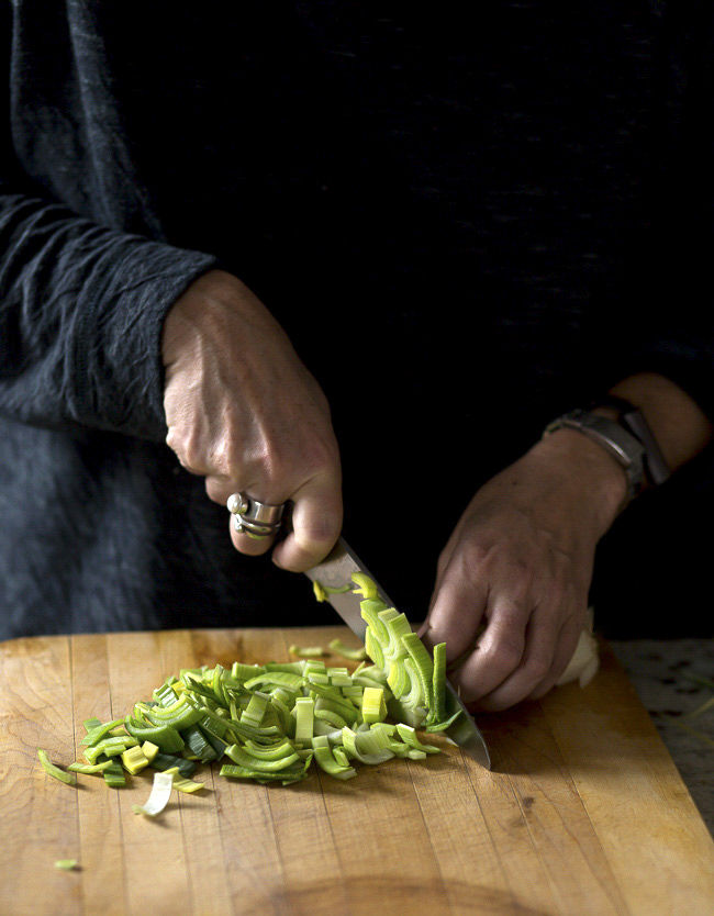 Slicing leeks to be charred- A Stack of Dishes